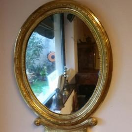 Specchio ovale in oro a foglia '800